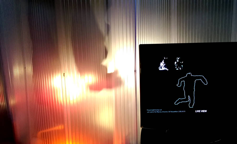 Movement Alphabet by Jan Lee and Tim Murray-Browne. At GAS Station London, audience view showing a live render of a participant experiencing the immersive performance within the interaction pod.